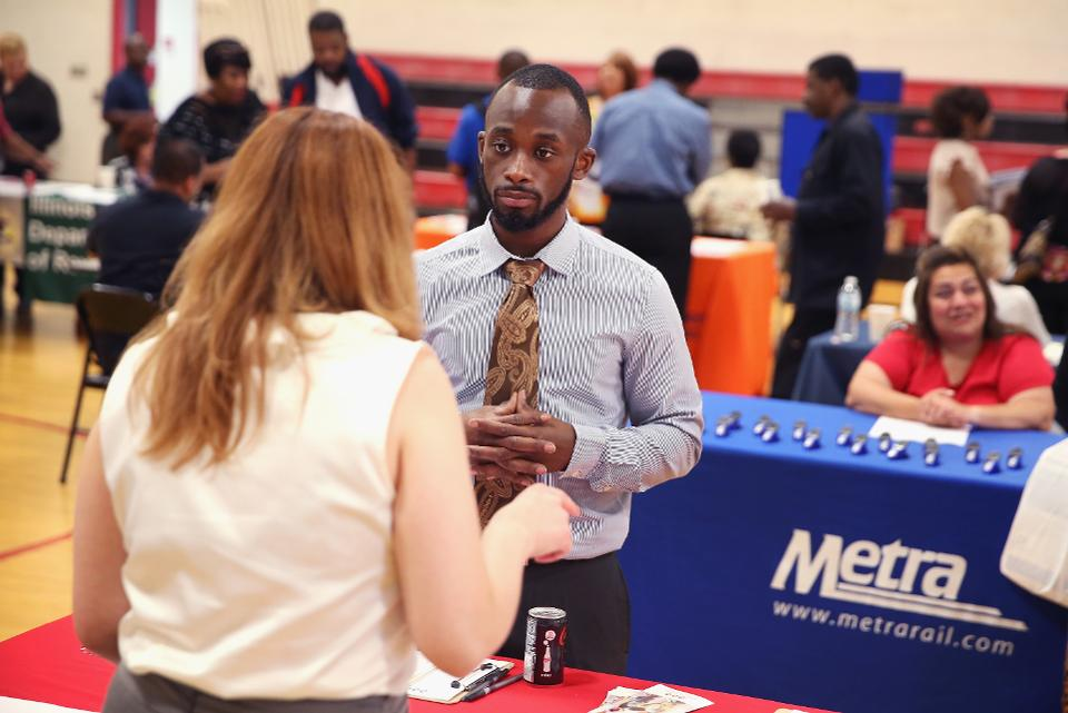 Job seekers attend a career fair. Many of the challenges black households face have to do with not benefiting from job and wage growth.