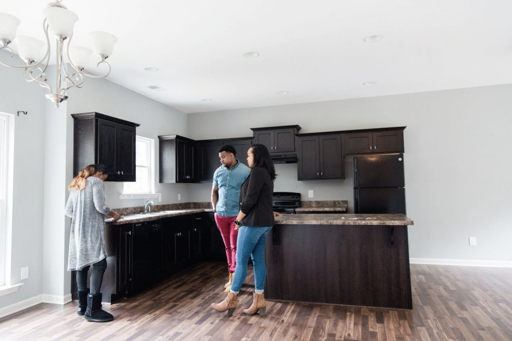 Mishaè Dickerson and Astardii and Rick Hopkins look at a kitchen. (Cameron Carnes/For The Washington Post)