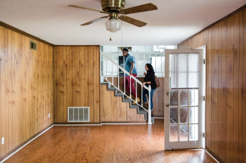 Rick and Astardii Hopkins explore a home. The National Association of Real Estate Brokers recently launched a campaign aimed at getting younger people of color to embrace homeownership. (Cameron Carnes/For The Washington Post)