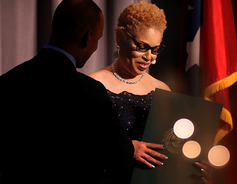 Cheryl Muhammad, incoming president of the National Association of Real Estate Brokers' Memphis chapter, accepts a proclamation from Shelby County Commissioner Van Turner during an event for NAREB's 2019-20 officers held at the University of Memphis Holiday Inn on Friday, Jan. 11. (Patrick Lantrip/Daily Memphian)