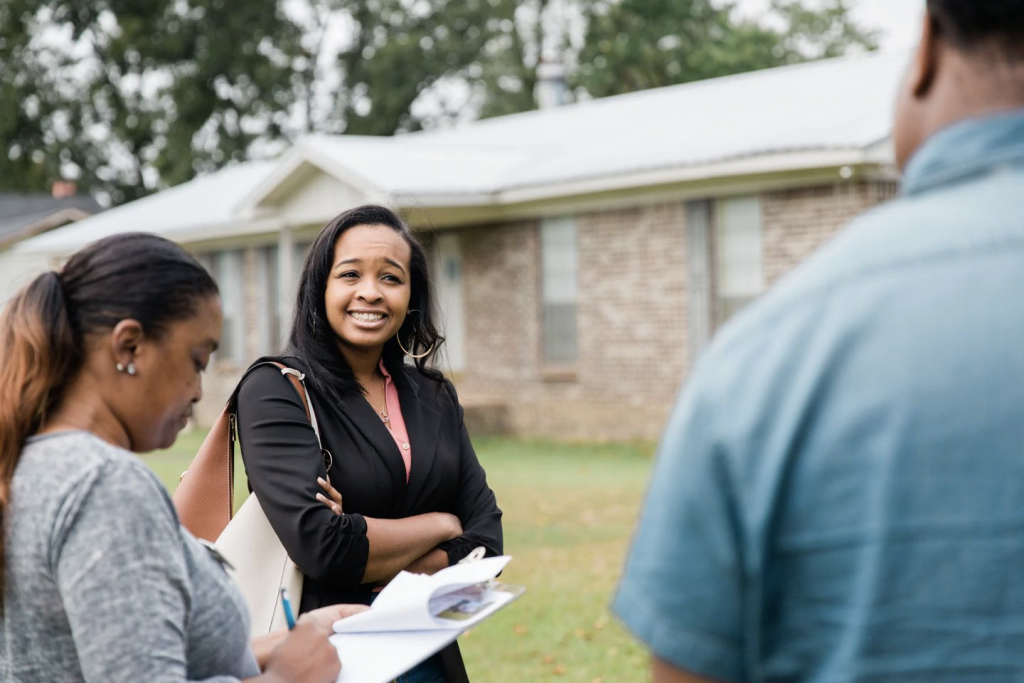 Realtor Mishaè Dickerson, left, shows a home to Astardii and Rick Hopkins in Birmingham, Ala., last month. The couple say their college loan debt limited their options. (Cameron Carnes/For The Washington Post)