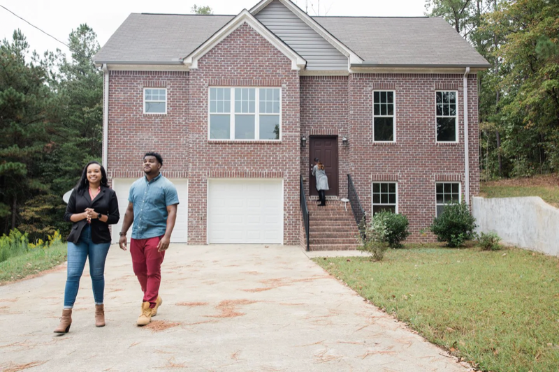 """Rick and Astardii Hopkins examine a for-sale property in Birmingham, Ala. """"The [student] loans hit us pretty hard,"""" Rick says. """"It basically limited what we could save for a down payment and how much we could borrow from the bank."""" (Cameron Carnes/For The Washington Post)"""